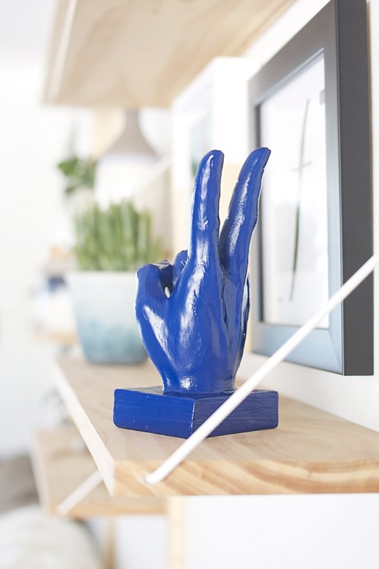 See how an old and ordinary hand sculpture was transformed into a beautiful DIY hand sculpture using a vibrant color paint!