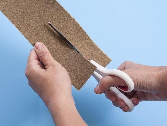 Sandpaper and scissor